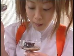 Japanese brunette with a fetish licking a glass