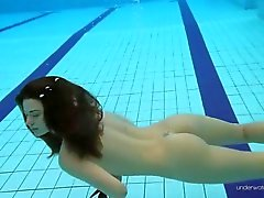 Her slender teen body is perfect under the water