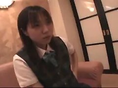 Adorable Japanese teen blows a long dick and exposes her ha