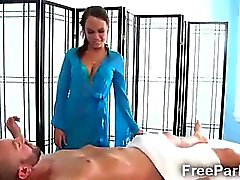 Gorgeous therapist strokes clients dong for some extra bucks