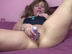 MILF brunette Brandi plays with her toy