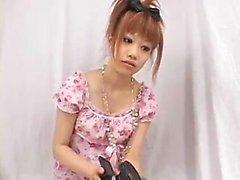 Beautiful Oriental teen having fun with her boyfriend in th