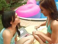 Sexy brunette lesbians fuck at poolside