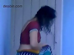 Next door desi bhabhi changing dress on balcony