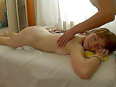 Slender babe gets pounded on a massage bed