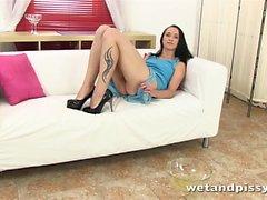 Kinky brunette pisses into her high heels