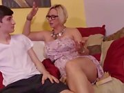 Busty mature cougar gives young boy the best handjob ever