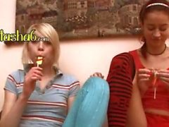 two naked lezzies testing lollipops