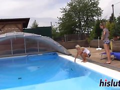 Two young lesbians fuck in the pool