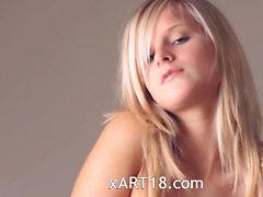 Busty blond teen dildoing snatch