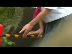 Teen makes outdoor fingering