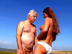 Busty teeny fucks old man on the beach