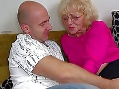 HOT Young guy fucking granny with strapon