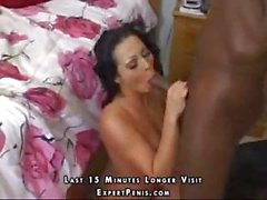 Busty brunette eats his black rod and then gets drilled by it in both holes