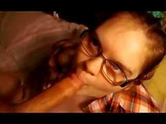 horny wife with glasses sucks dick,licking balls,with a cumshot to the face