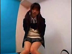 Provoking Japanese schoolgirl with pigtails displays her sw