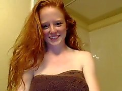 Cute redhead teen bathing