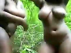 Busty Black Teens Strip In The Jungle