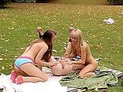 Three pornstars fucking on the grass