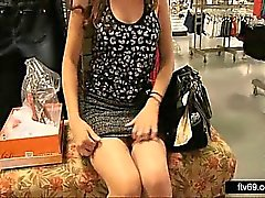 Leggy brunette lady tease and upskirt at the shopping mall
