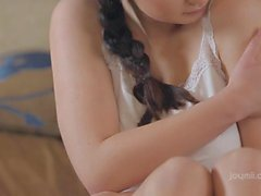 Teen honey satisfies herself in a softcore act
