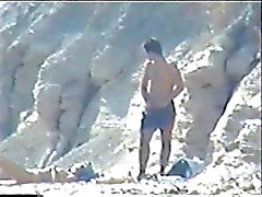 Shy couple caught on the nudist beach