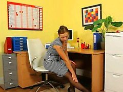 Ultra sexy secretary posing in office