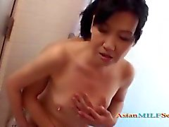 Mature Woman Sucking off a Young Guy Under The Shower