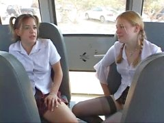 Two teen schoolgirls suck cock on bus